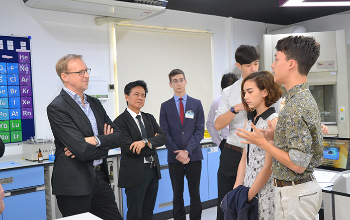 The Ambassador chats with students and teachers during his tour of the new science lab.