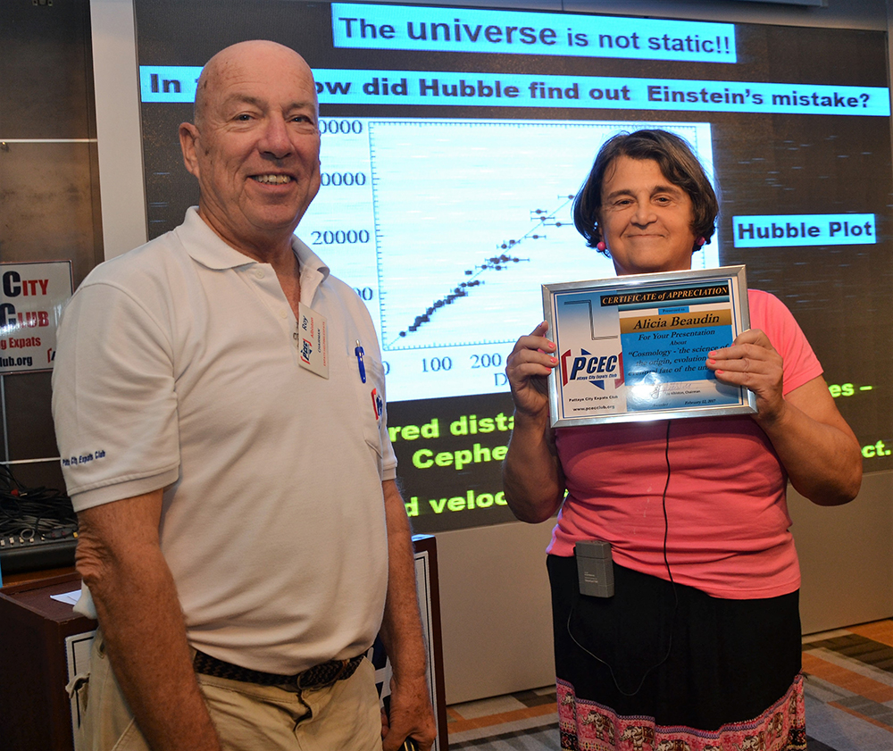 MC Roy Albiston presents the PCEC's Certificate of Appreciation to member Alicia Beaudin for her interesting and informative talk on Cosmology.