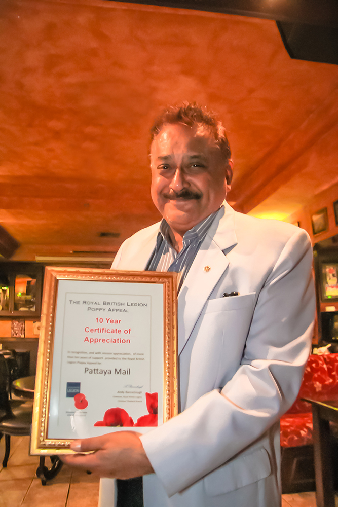 Peter Malhotra proudly displays the Certificate of Appreciation presented to Pattaya Mail for the more than 10 years of fulsome, and most generous support, to all the activities of the Royal British Legion in Thailand.
