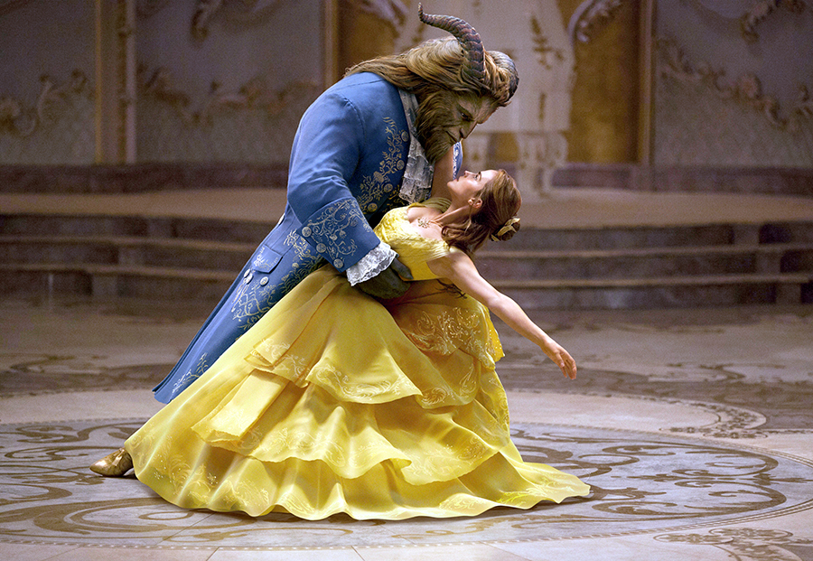 "This image shows Dan Stevens as The Beast, left, and Emma Watson as Belle in a live-action adaptation of the animated classic ""Beauty and the Beast."" (Disney via AP)"