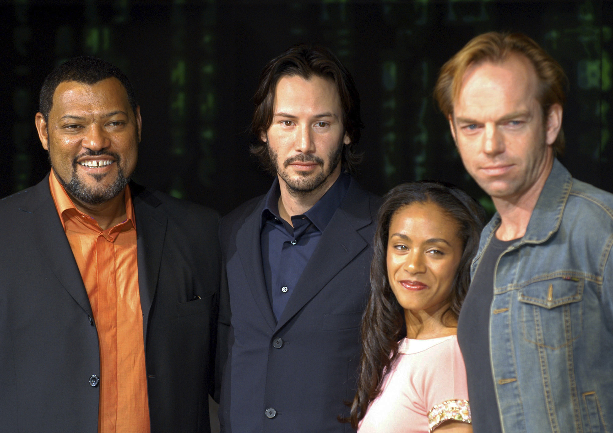 From left: Matrix cast members Laurence Fishburne, Keanu Reeves, Jada Pinkett Smith and Hugo Weaving are shown in this May 27, 2003 file photo. (AP Photo/Koji Sasahara)