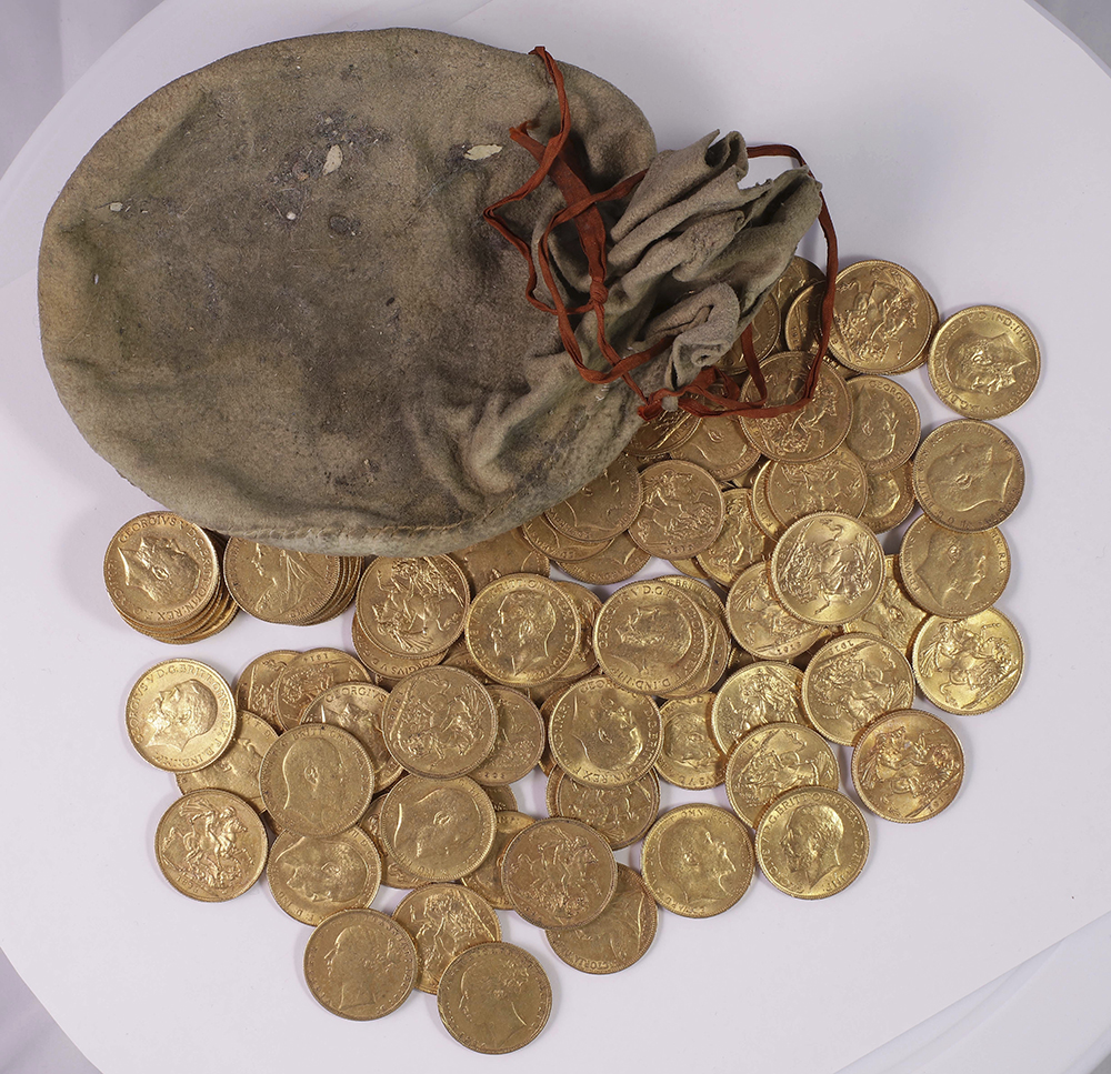 An undated handout photograph, taken at an unknown location, shows part of a hoard of gold coins, made between 1847 and 1915, discovered hidden in an upright piano made by Broadwood & Sons of London and sold to a music establishment in Essex, England, in 1906. (Portable Antiquities Scheme/Trustees of the British Museum/Peter Reavill via AP)