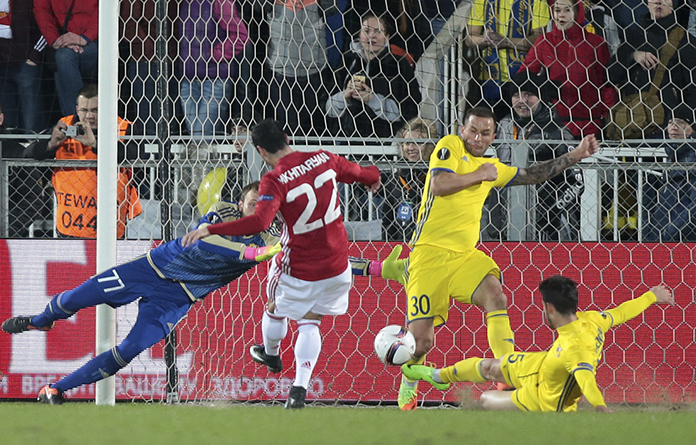 Manchester United's Henrikh Mkhitaryan, centre, scores during the Europa League round of 16 first leg match against FC Rostov in Rostov-on-Don, Russia, Thursday, March 9. (AP Photo/Denis Tyrin)
