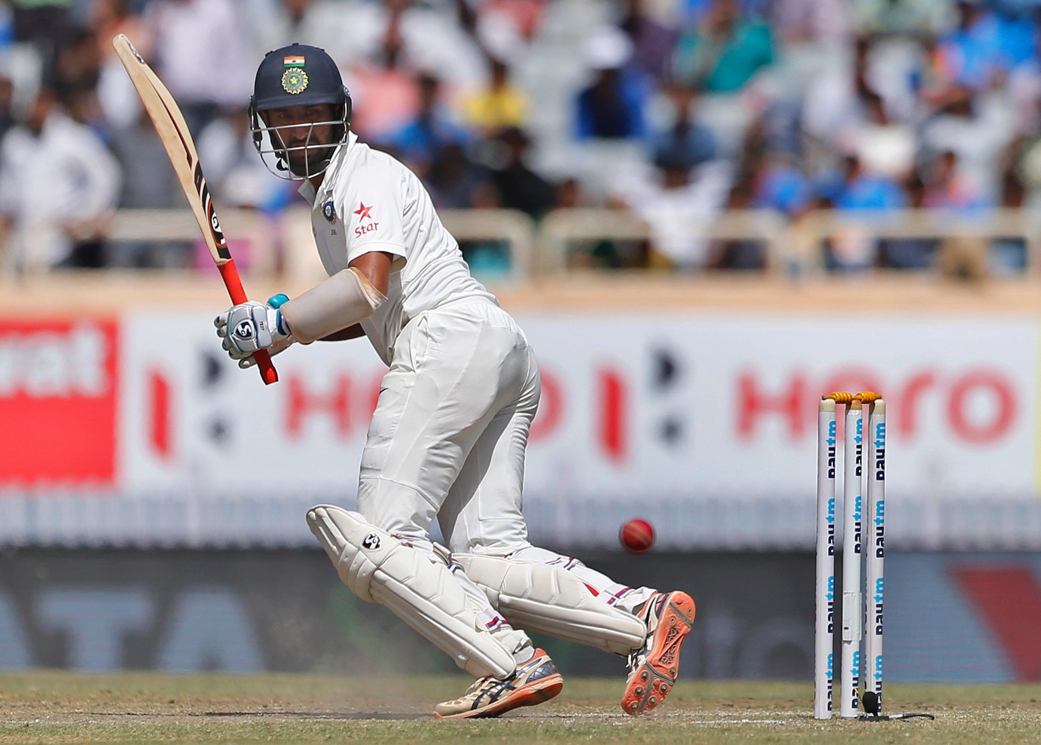 India's Cheteshwar Pujara plays a shot during the third day of the third test cricket match against Australia in Ranchi, India, Saturday, March 18. (AP Photo/Aijaz Rahi)