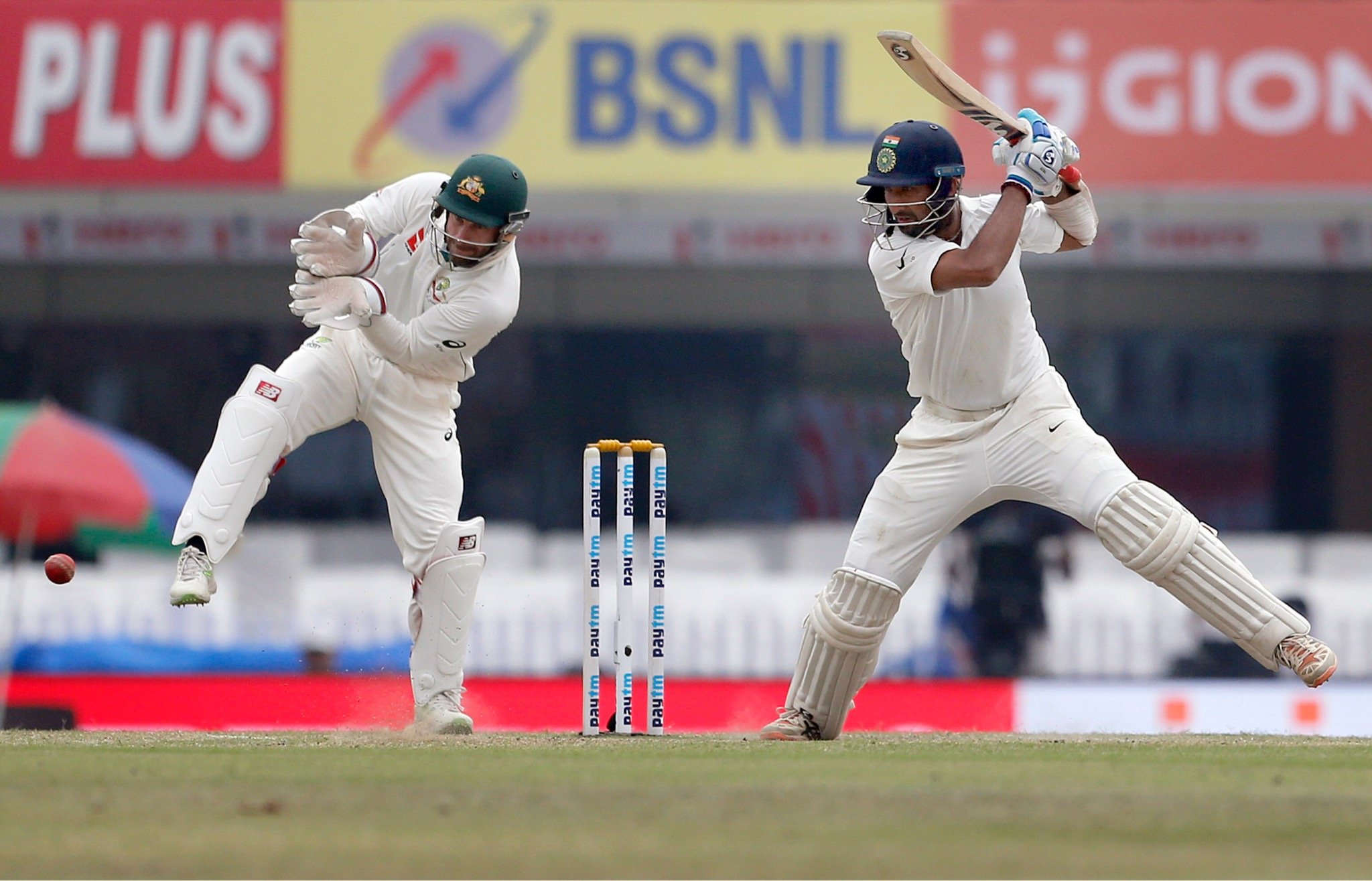 India's Cheteshwar Pujara, right, plays a shot during the fourth day of the third test against Australia in Ranchi, India, Sunday, March 19. (AP Photo/Aijaz Rahi)