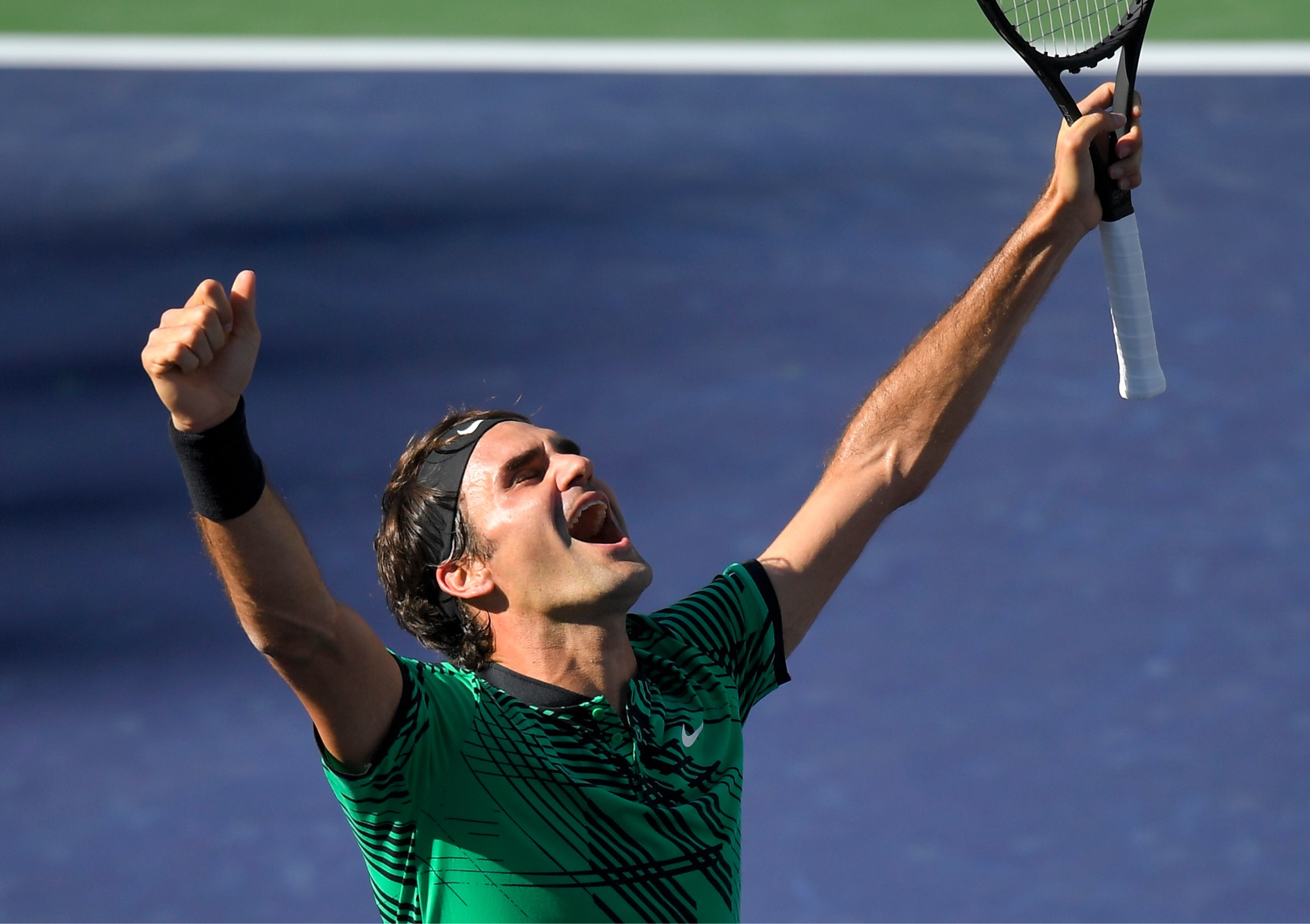 Roger Federer, of Switzerland, celebrates his win against Stan Wawrinka, also of Switzerland, in the men's final at the BNP Paribas Open tennis tournament, Sunday, March 19, in Indian Wells, Calif. (AP Photo/Mark J. Terrill)