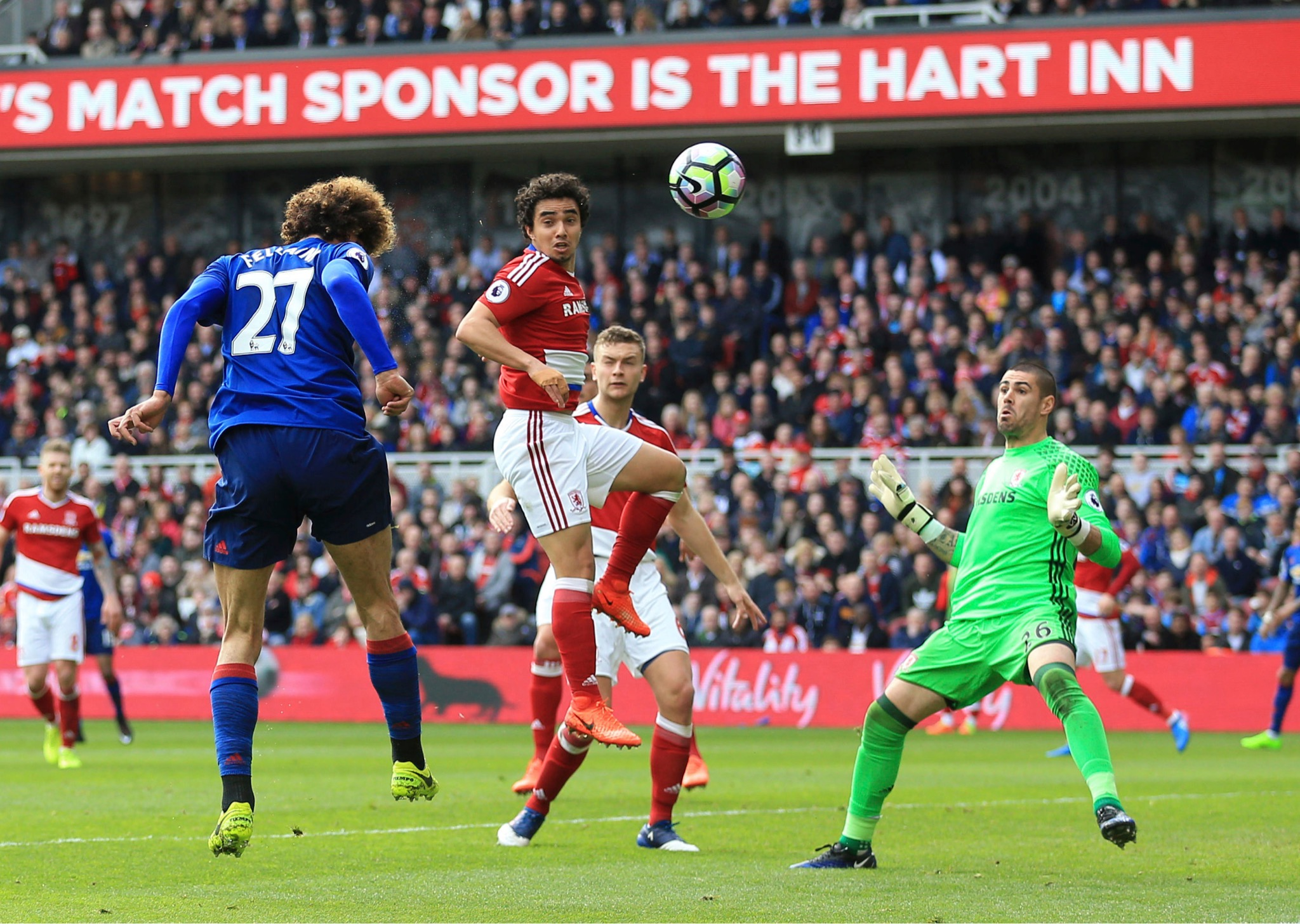 Manchester United's Marouane Fellaini, left, scores his side's first goal of their EPL game against Middlesbrough at the Riverside Stadium in Middlesbrough, Sunday, March 19. (Nigel French/PA via AP)