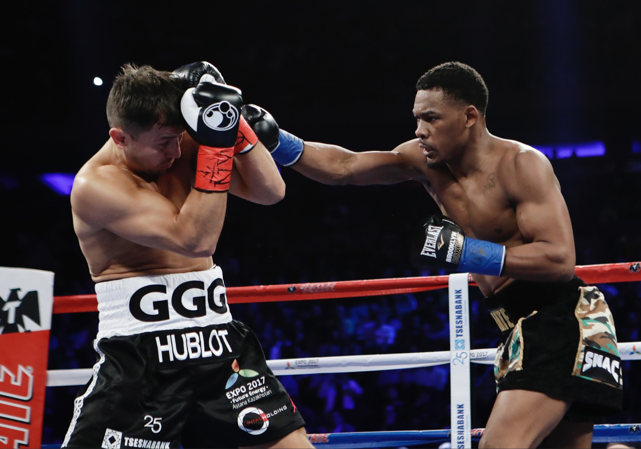 Daniel Jacobs, right, punches Gennady Golovkin, of Kazakhstan, during the first round of their middleweight boxing match early Sunday, March 19, in New York. (AP Photo/Frank Franklin II)