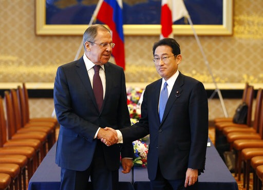 Russian Foreign Minister Sergei Lavrov, left, shakes hands with Japanese Foreign Minister Fumio Kishida at the start of their meeting as a part of Japan-Russia foreign and defence ministers meeting at Iikura guest house in Tokyo, Japan Monday, March 20, 2017. (Issei Kato/Pool Photo via AP)