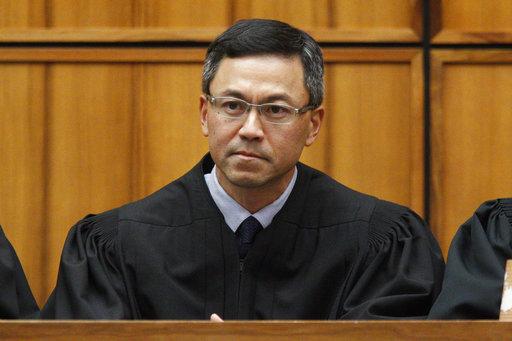 This December 2015 photo shows U.S. District Judge Derrick Watson in Honolulu. (George Lee/The Star-Advertiser via AP)