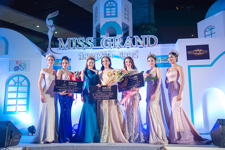 "Miss Grand Chonburi winner Sudaporn ""Amm"" Wongsasiripat (center) is congratulated by runners-up and past champions."