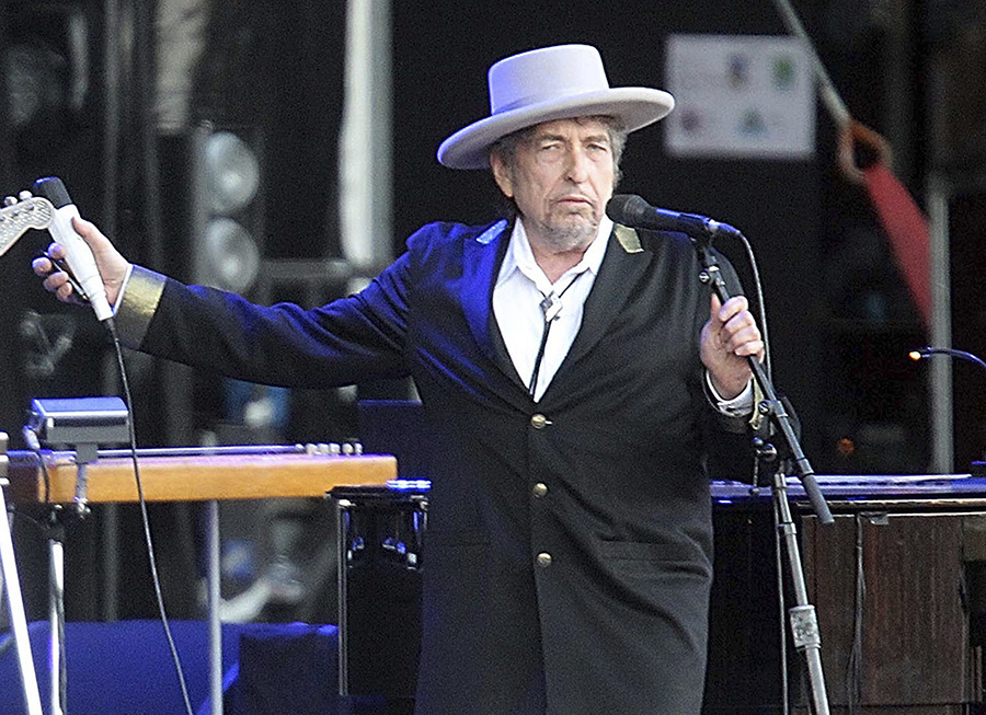 This July 22, 2012 file photo shows U.S. singer-songwriter Bob Dylan performing in Carhaix, western France. (AP Photo/David Vincent)