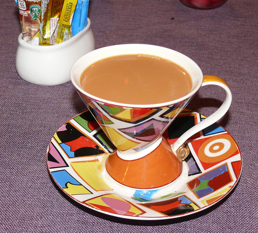 The exotic Masala Chai brewed with a mixture of aromatic Indian spices and herbs, served in a Clarice Cliff cup and saucer.