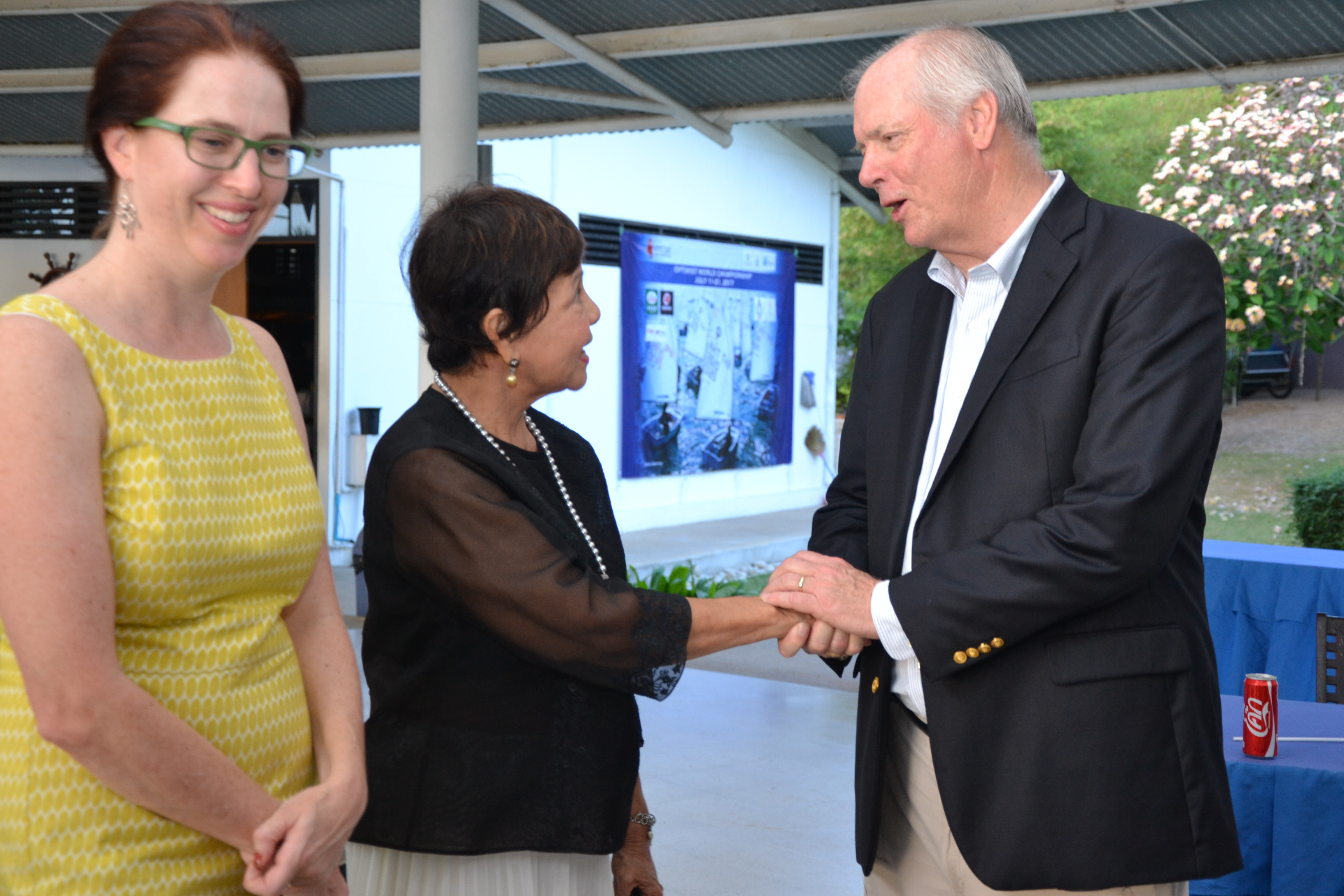 Anne Lee Seshadri, Cultural & Educational Officer of the US Embassy Bangkok seems delighted as Gary Jobson greets Sopin Thappajug.