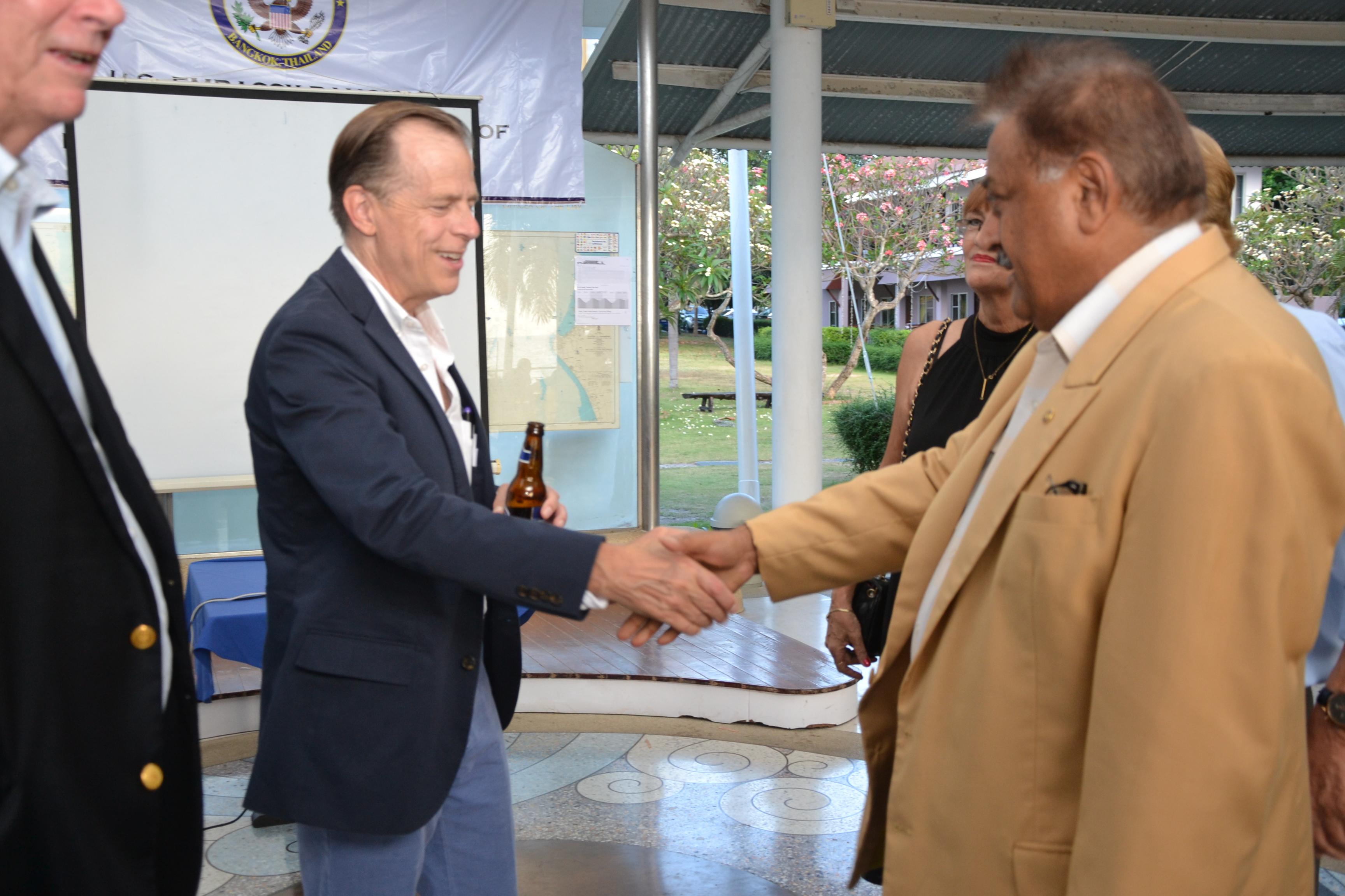 US Ambassador H.E. Glyn T. Davies welcomes Pratheep 'Peter' Malhotra, MD of Pattaya Mail.