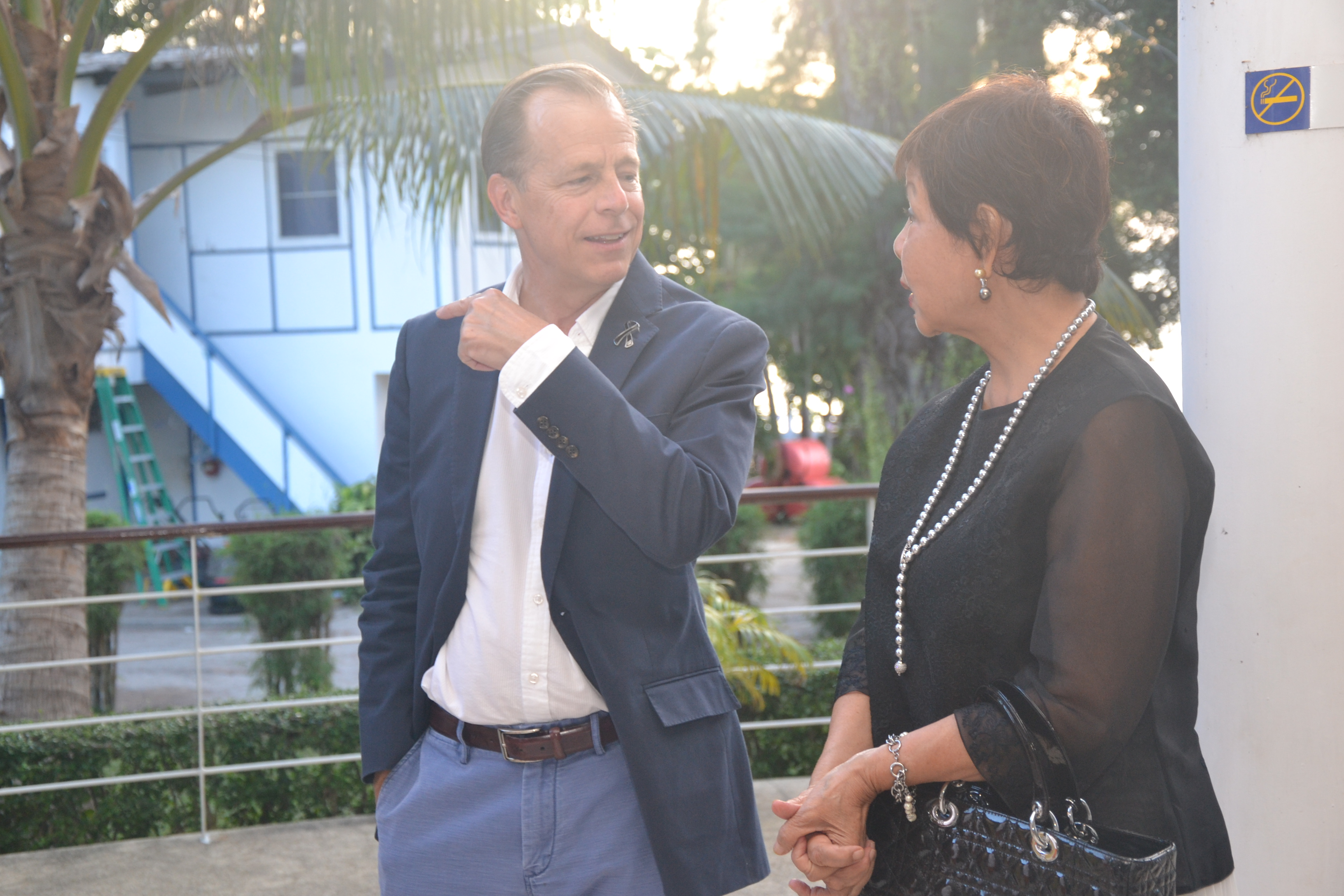 Ambassador Davies converses with Sopin Thappajug.