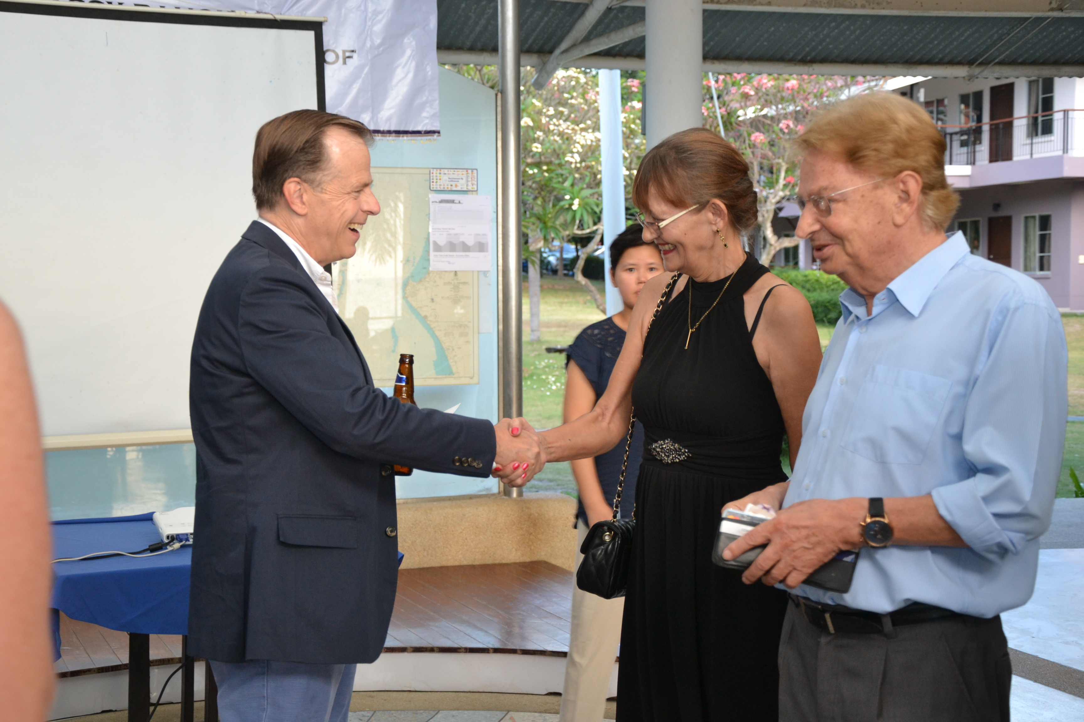 Ambassador Davies welcomes Princess Iris of Saxony and Hans Mueller.