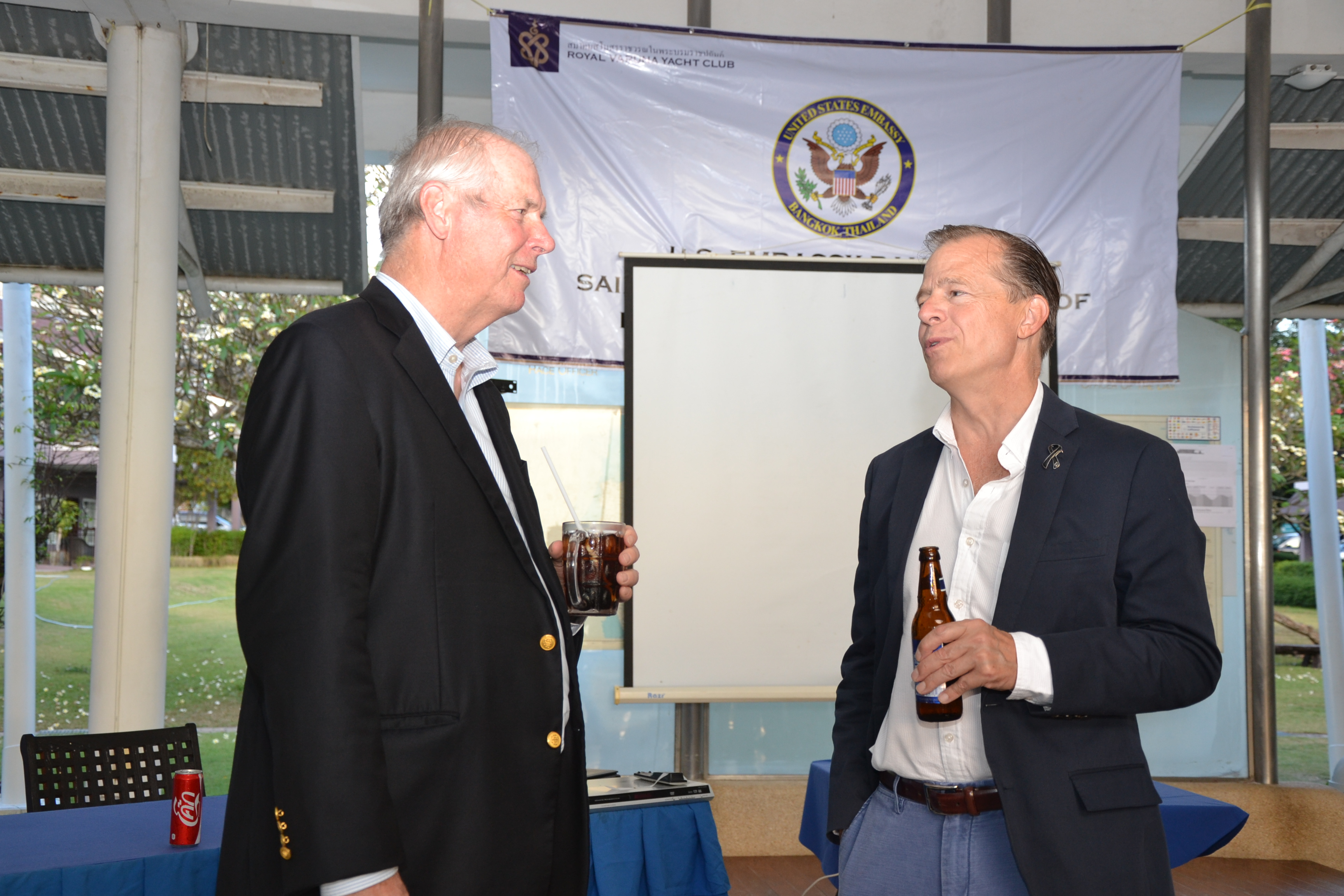 Gary Jobson and Ambassador Davies engage in light conversation.