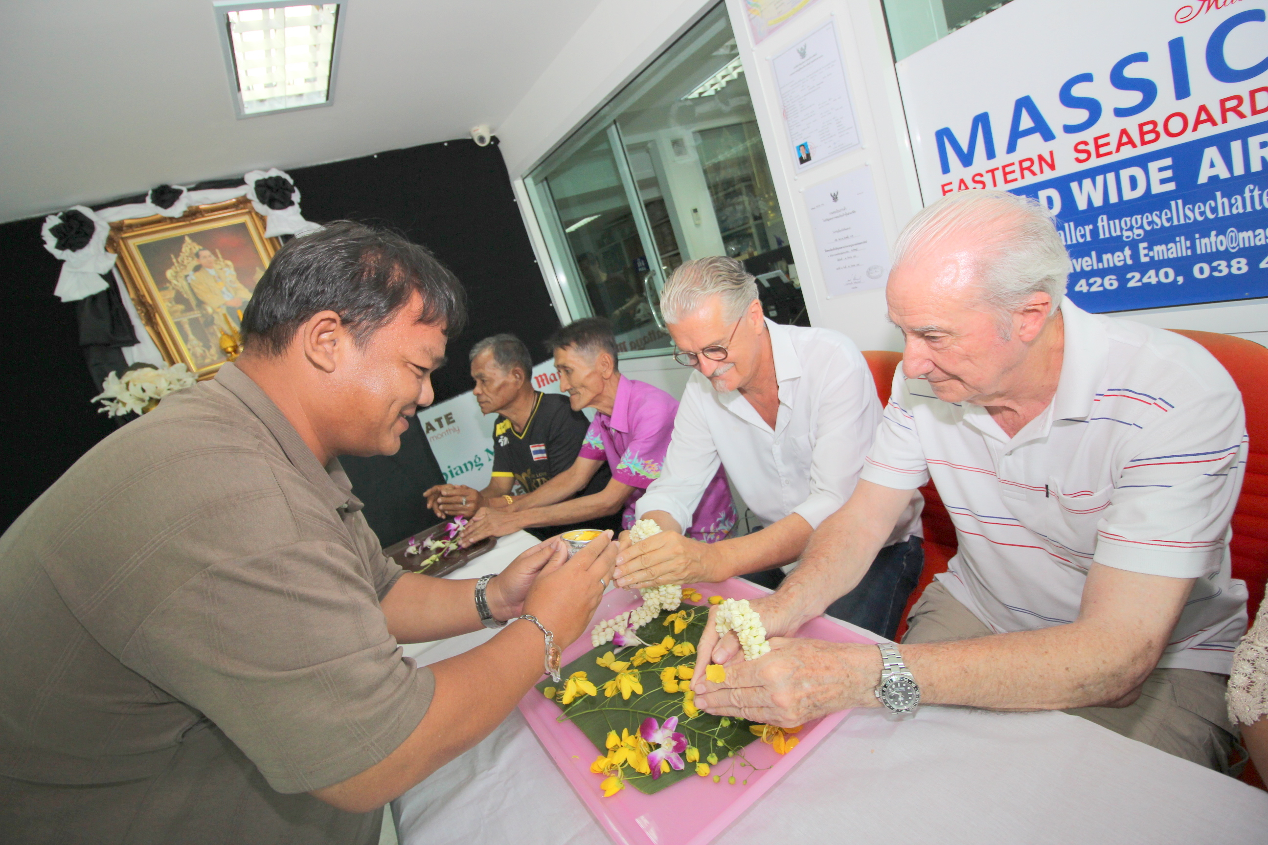 Thanawat Suansuk receives blessings from Jo Klemm and Dr. Iain Corness.