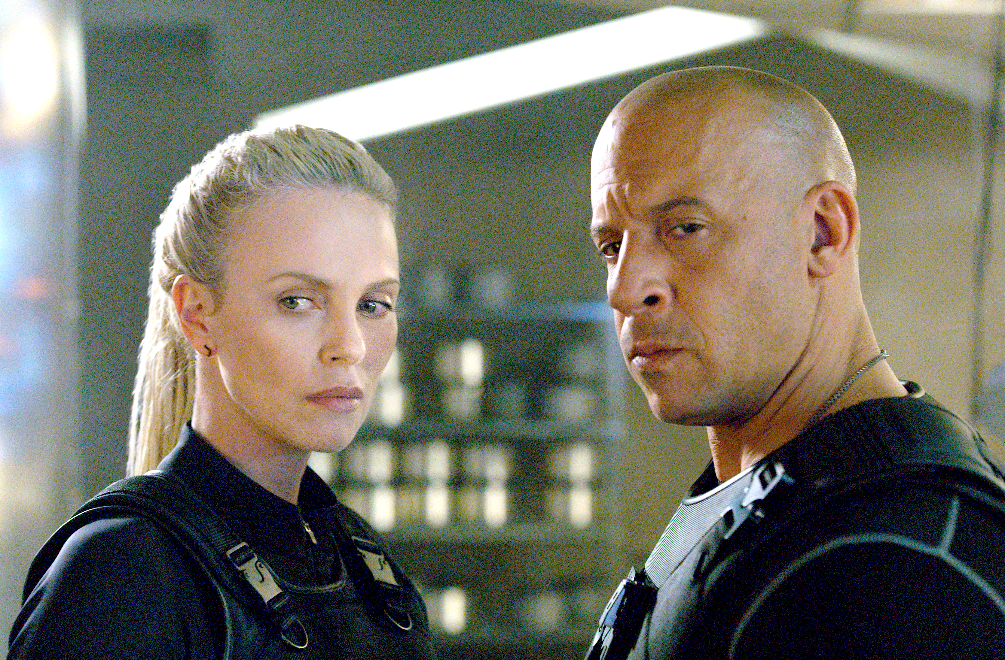 "This image shows Charlize Theron (left) and Vin Diesel in ""The Fate of the Furious."" (Universal Pictures via AP)"