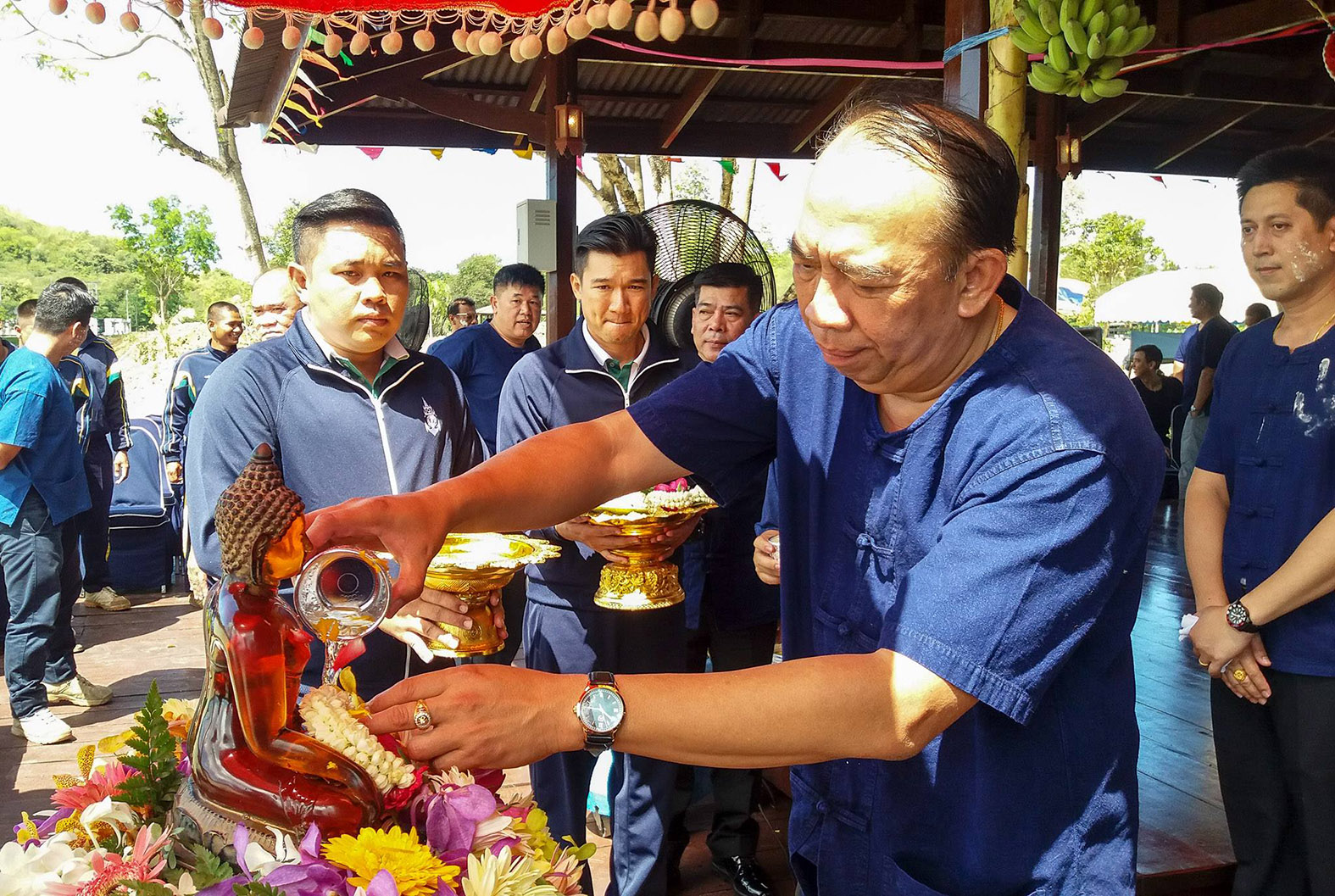 Rear Adm. Eakaraj Phomlumpak, commander of the Air and Coastal Defense Command, pours scented water on the Buddha statue.
