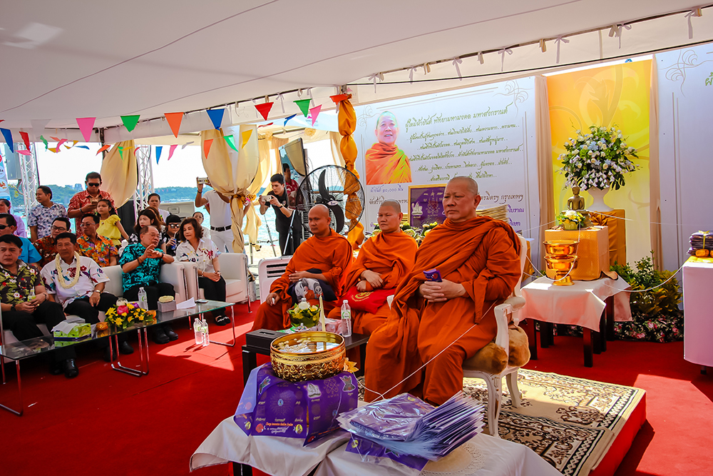 Tongchai Wattraimitwitthayaram Worawihan presides over a ceremony blessing 11,000 pieces of Pha Yants to give out.