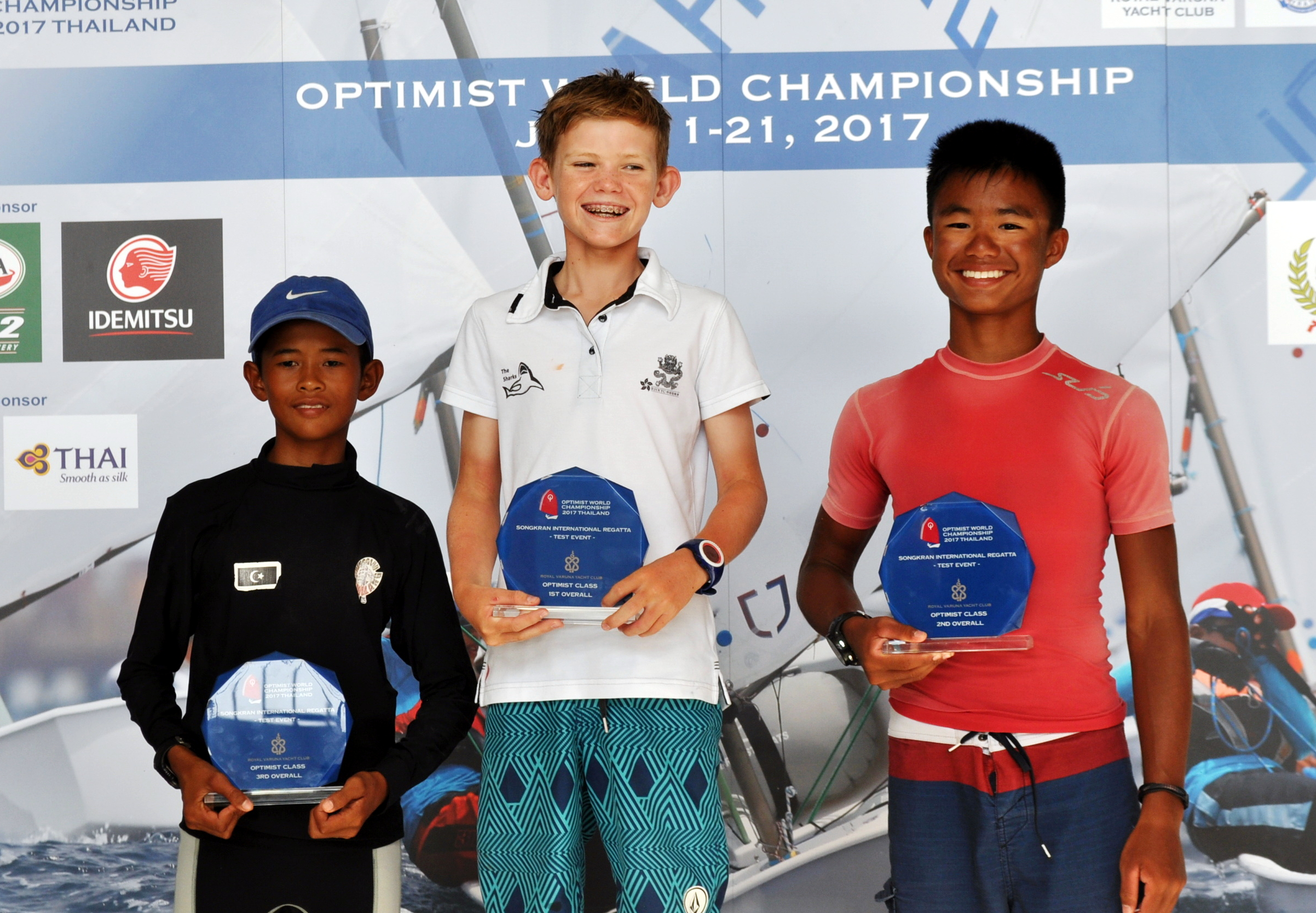 Individual winner Duncan Gregor of Hong Kong (centre) poses on the podium with Muhammed Khaidir Bin Mohd Zahawi from Malaysia (left) and Muhammad Daniel Kei, representing Singapore (right).