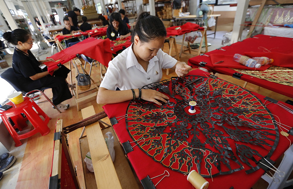 Women embroider intricate patterns to decorate the royal crematorium for the late Thai King Bhumibol Adulyadej at the Office of Traditional Arts in Nakhon Pathom province, Thursday, April 20, 2017. (AP Photo/Sakchai Lalit)