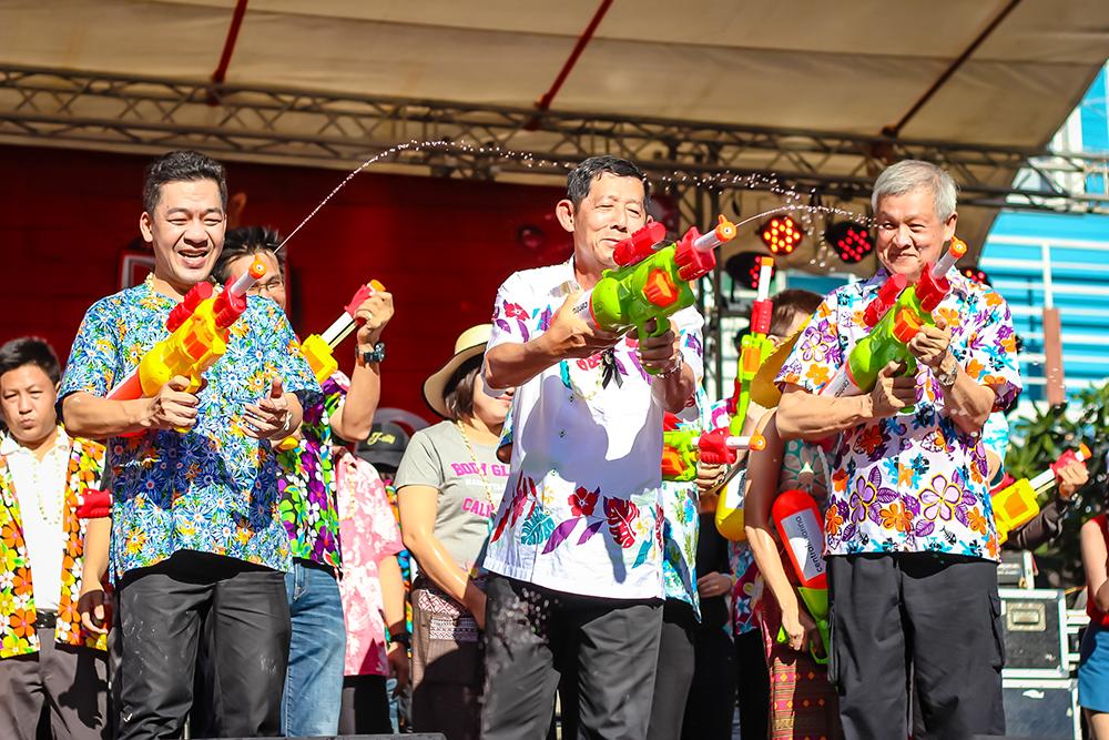 TAT Deputy Director Akapon Taweesuntorn, Mayor Anan Charoenchasri, and Deputy Mayor Apichart Worapol take part in the fun during the official opening of Songkran in Pattaya.