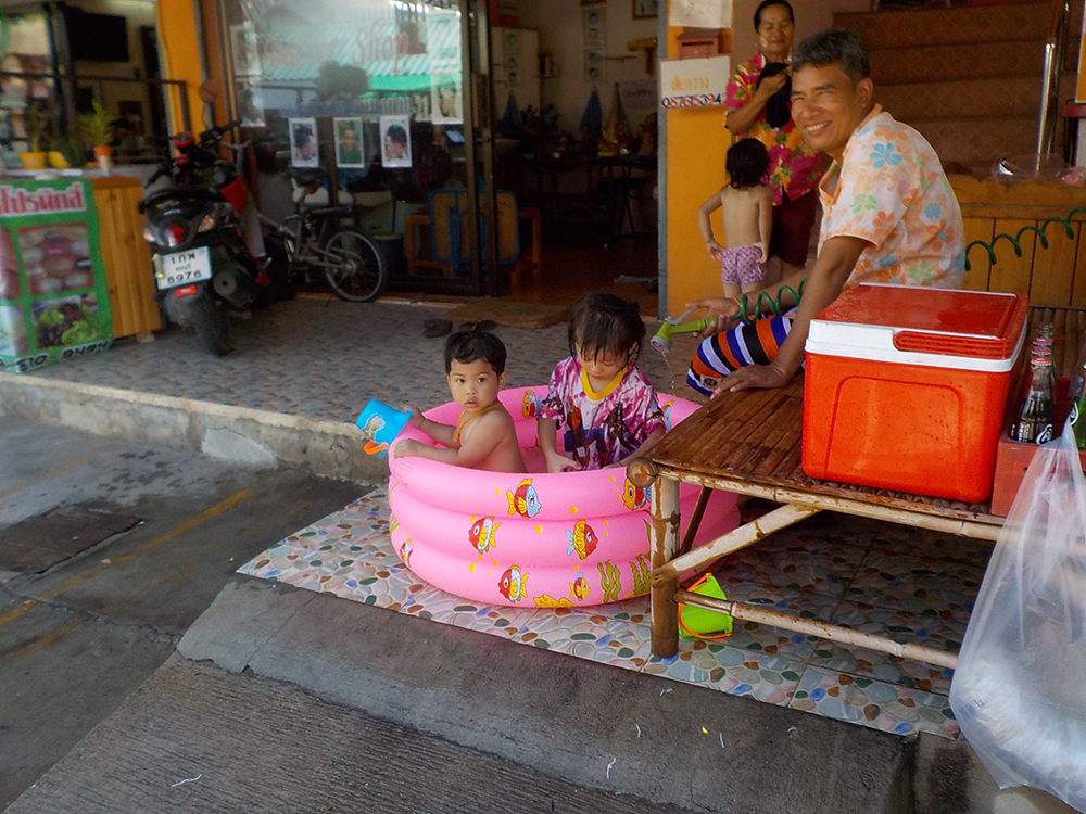 Never too young to cool off during a Soi Kophai Songkran.