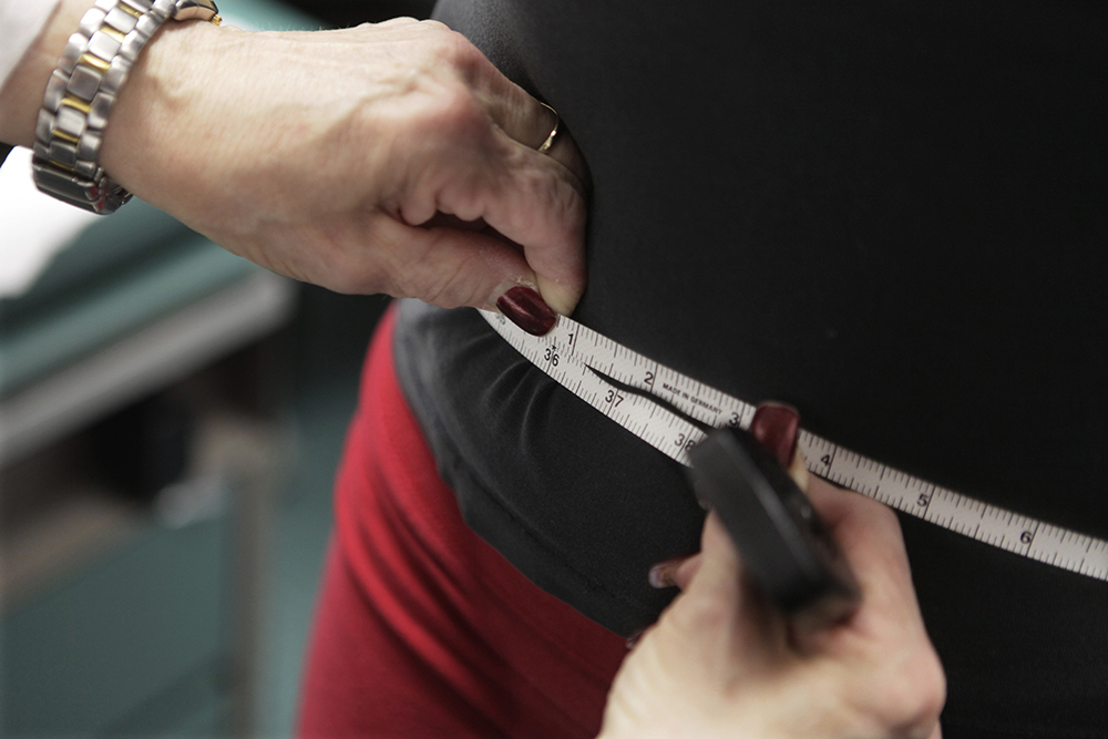 A study published Wednesday, April 5, 2017 in the New England Journal of Medicine suggests gaining and losing weight repeatedly may be dangerous for overweight heart patients. (AP Photo/M. Spencer Green, File)