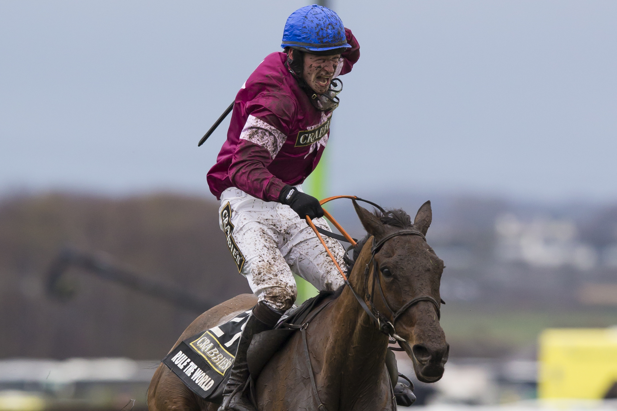 This is a Saturday, April 9, 2016 file photo shows David Mullins as he celebrates victory on Rule The World in the Grand National horse race at Aintree Racecourse in Liverpool, England. (AP Photo/Jon Super)