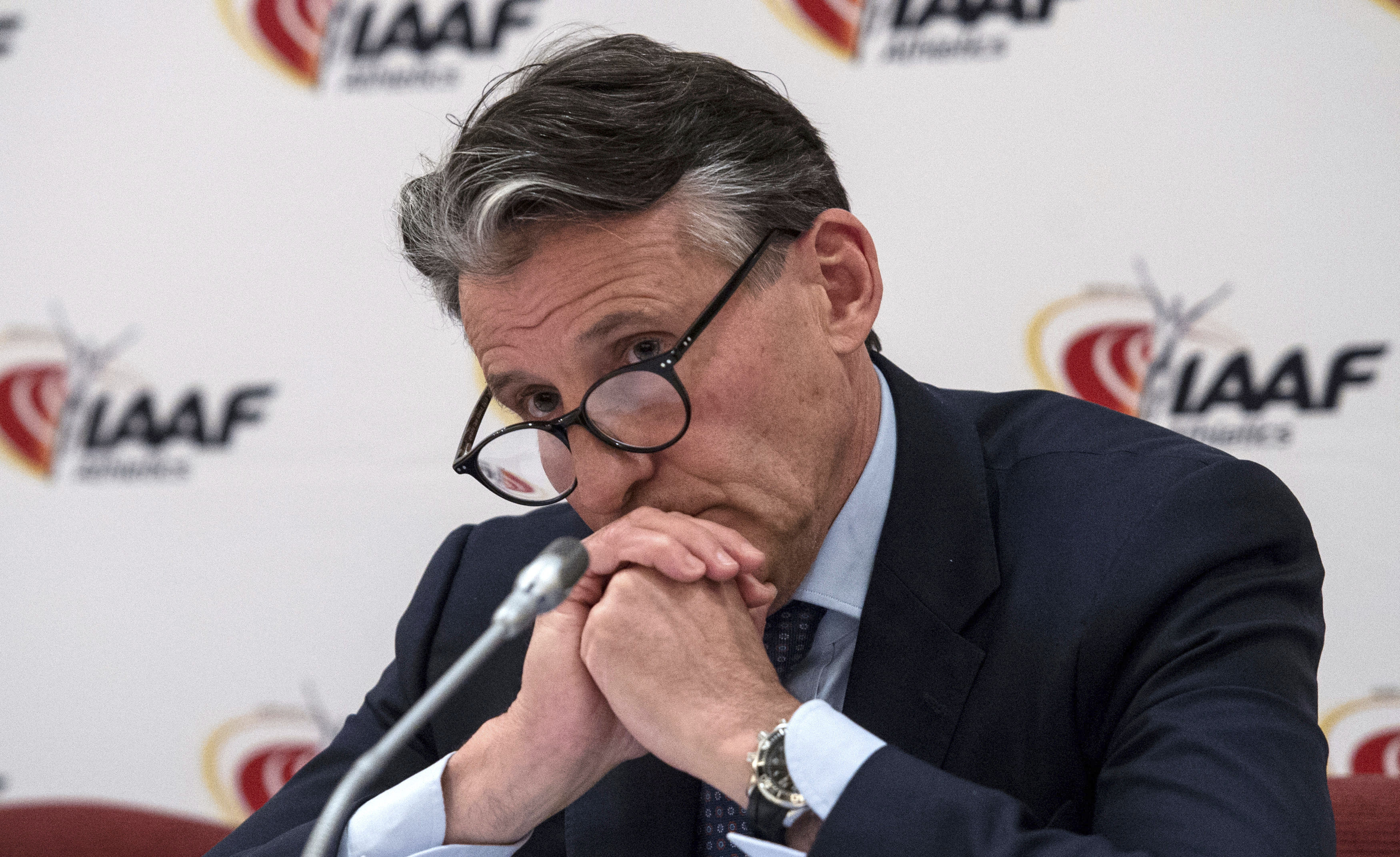 IAAF President Lord Sebastian Coe listens to a reporter's question during a press conference in London, Thursday April 13. (Lauren Hurley/PA via AP)