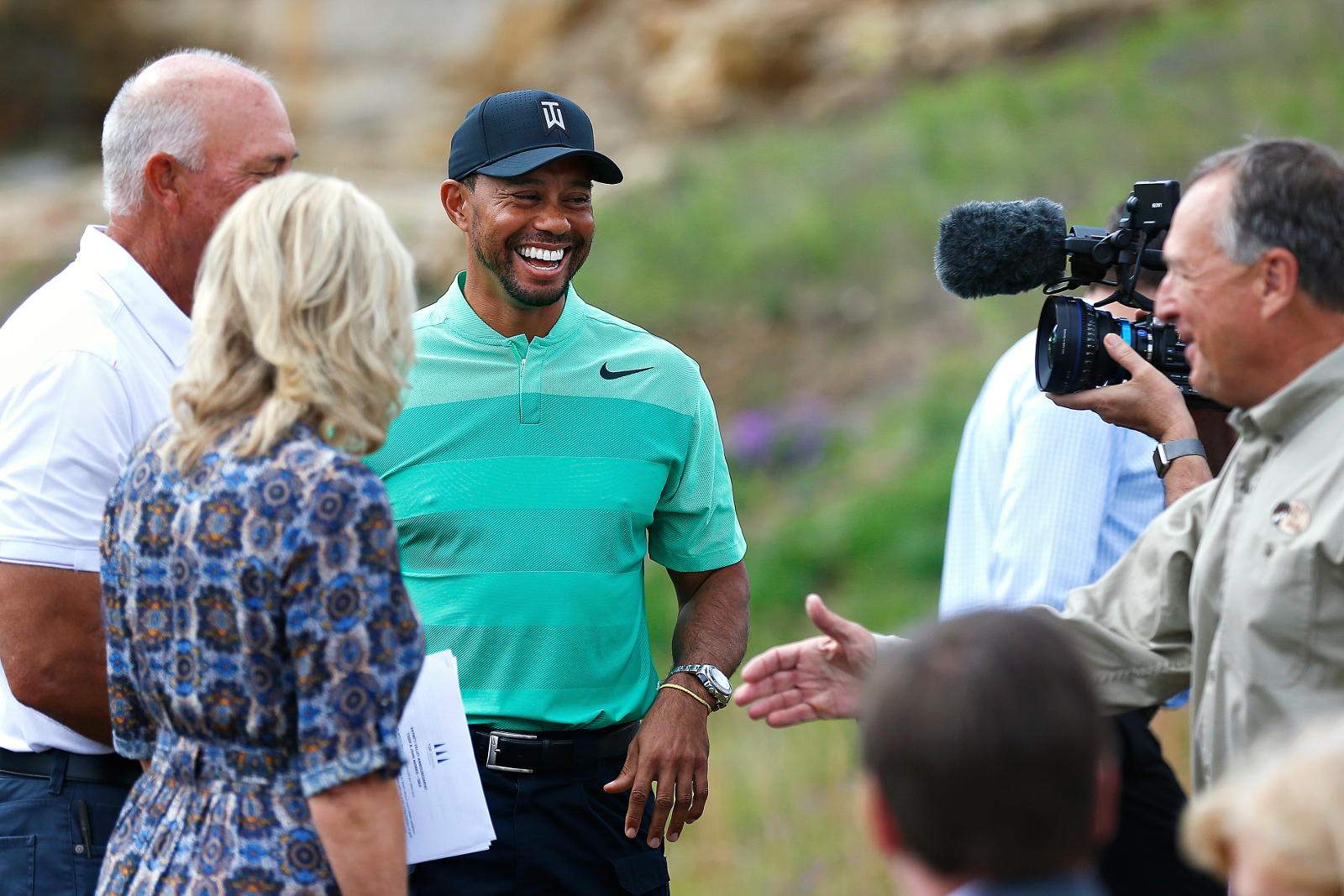 Tiger Woods smiles during a press event for a new golf course he designed in Hollister, Missouri, Tuesday, April 18. (Guillermo Martinez/The Springfield News-Leader via AP)