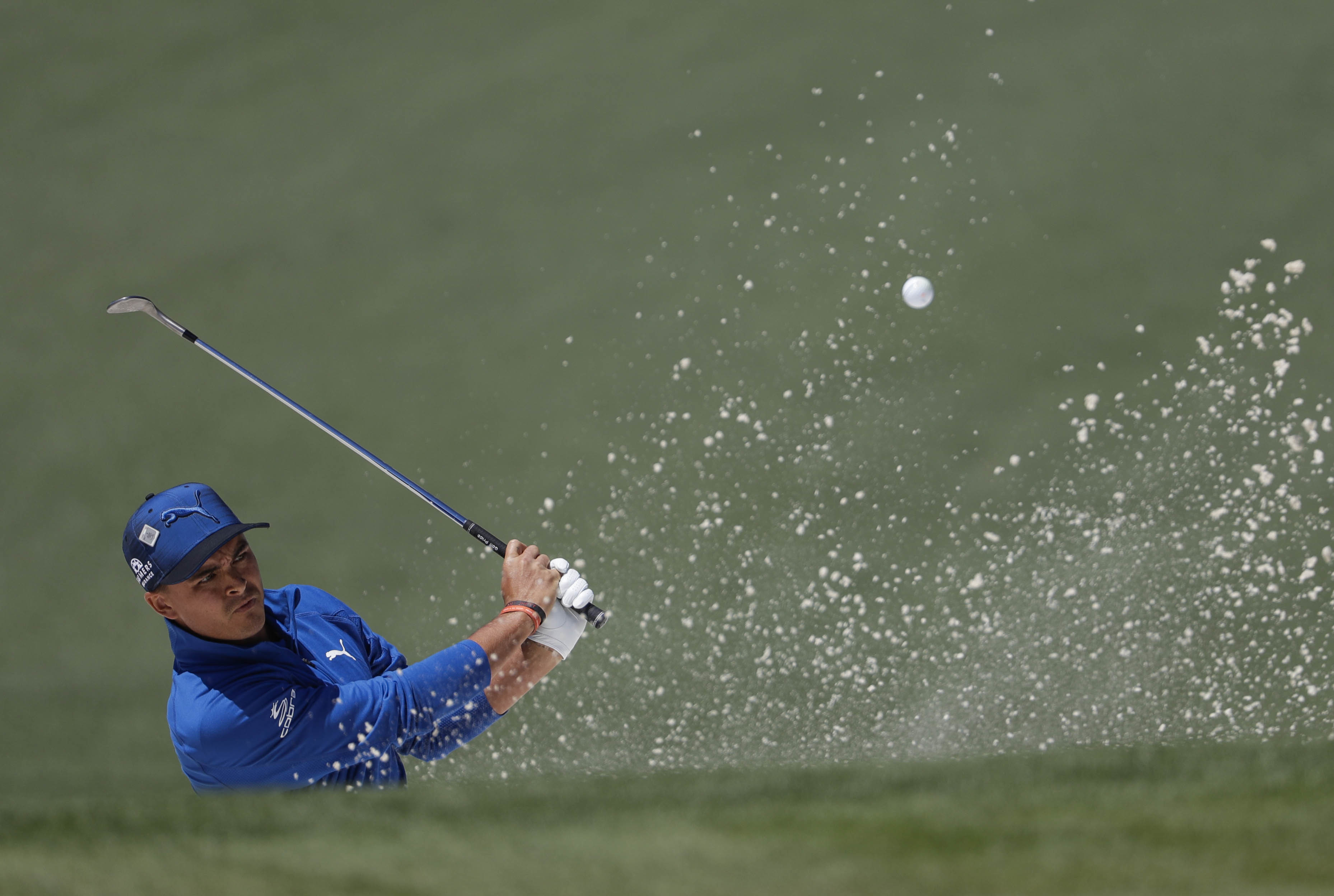 Rickie Fowler hits from a bunker on the second hole during the second round of the Masters golf tournament Friday, April 7, in Augusta, Ga. (AP Photo/David Goldman)