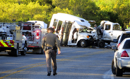 Authorities investigate after a deadly crash involving a van carrying church members and a pickup truck on U.S. 83 outside Garner State Park in northern Uvalde County, Texas, Wednesday, March 29, 2017. (Zeke MacCormack/The San Antonio Express-News via AP)
