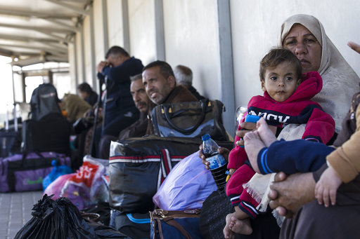 In this Sunday, March 26, 2017 photo, Palestinian residents of Gaza strip wait on the Israeli side of the Erez terminal to cross to Gaza Strip. (AP Photo/Tsafrir Abayov)