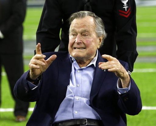In this Feb. 5, 2017, file photo, former President George H.W. Bush arrives on the field for a coin toss before the NFL Super Bowl 51 football game. (AP Photo/Eric Gay, File)