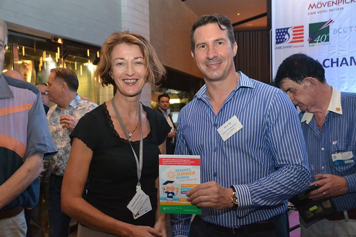 Joanna Kearney from Regents International School presents Andy Hall from CEA Project Logistics with a lucky draw prize.