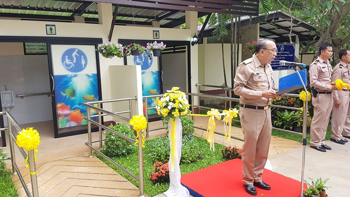 Rear Adm. Eagarat Promlumpug, commander of the Air and Coastal Defense Command, which runs the Sea Turtle Conservation Center, announces the opening of modern restrooms for the disabled there.