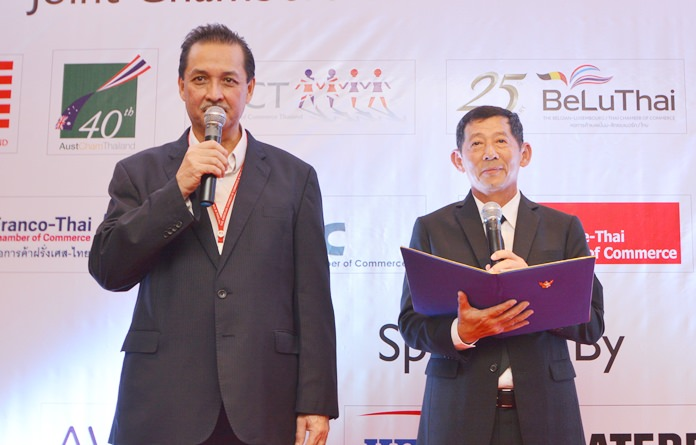 Mayor Anan Charoenchasri (right) addresses the guests. His speech is translated into English by a member of the American Chamber of Commerce Thailand.