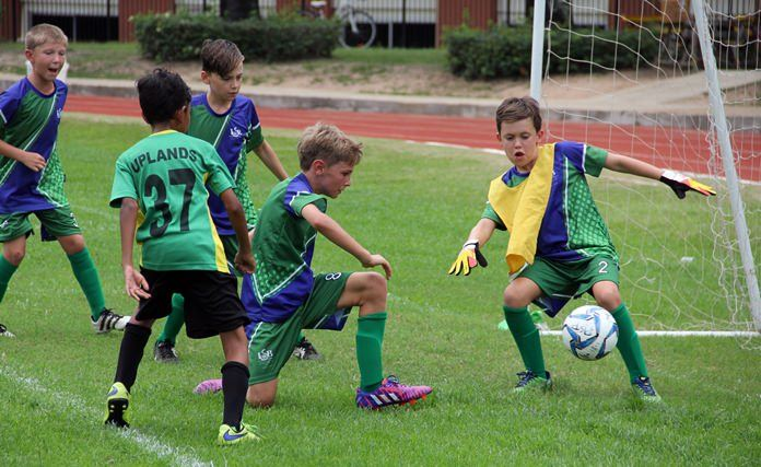 Uplands take on Intl. School Brunei on the football field.