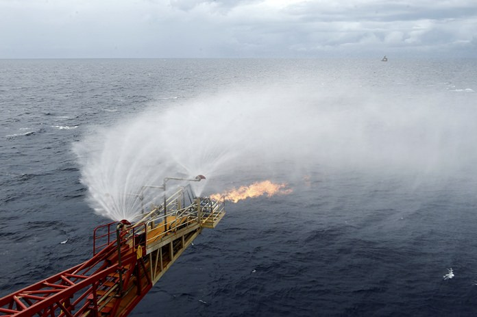 In this May 16, 2017 photo released by China's Xinhua News Agency, gas flares out from a drilling platform that extracted natural gas from combustible ice trapped under the seafloor of the South China Sea. Commercial development of the globe's vast reserves of a frozen fossil fuel known as combustible ice has moved closer to reality after Japan and China successfully extracted the material from the seafloor. (Liang Xu/Xinhua via AP)