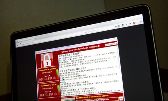A screenshot of the warning screen from a purported ransomware attack as captured by a computer user in Taiwan is seen on laptop in Beijing Saturday
