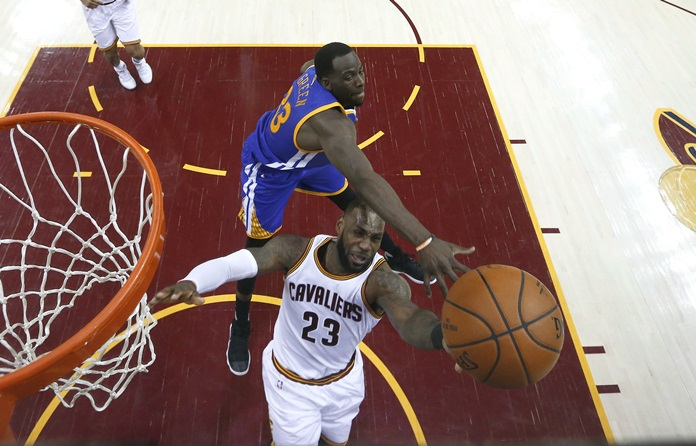Cleveland Cavaliers forward LeBron James (23) shoots as Golden State Warriors forward Draymond Green (23) defends during the first half of Game 4 of basketball's NBA Finals in Cleveland, Friday, June 9. (Larry W. Smith/Pool Photo via AP)