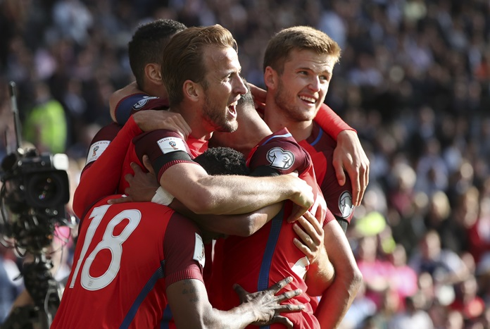 England's Harry Kane, center left, celebrates after scoring his side's second goal during the World Cup Group F qualifying match against Scotland at Hampden Park in Glasgow, Saturday, June 10. (AP Photo/Scott Heppell)