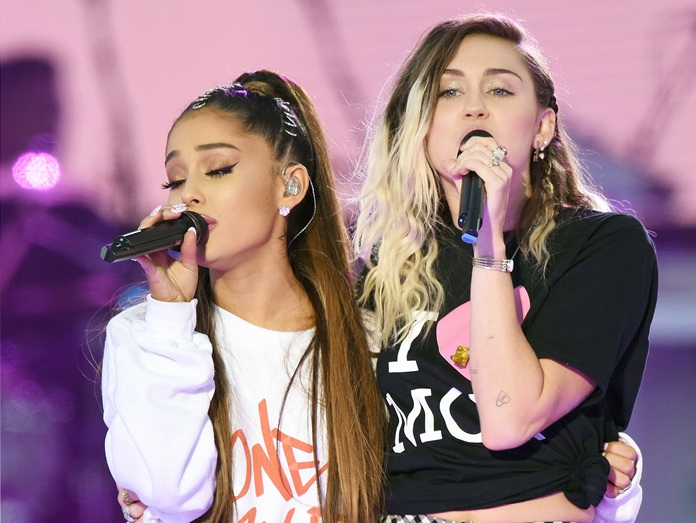 Ariana Grande (left) and Miley Cyrus perform at the One Love Manchester tribute concert in Manchester, north western England, Sunday, June 4. (Dave Hogan via AP)
