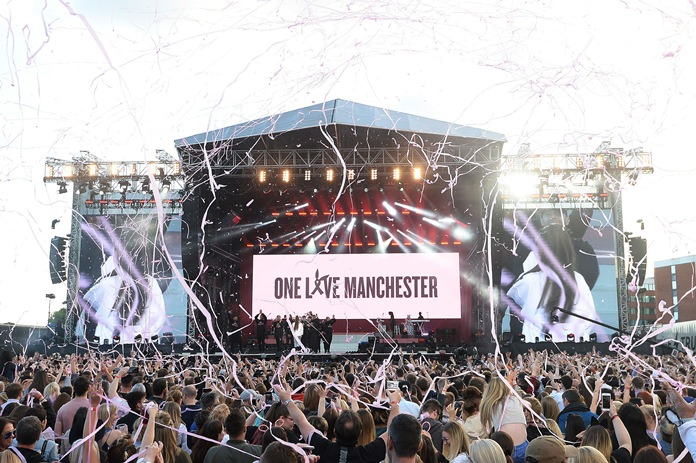 Crowds cheer at the One Love Manchester tribute concert in Manchester, Sunday, June 4. The event raised more than £10 million for those affected by the bombing in Manchester on May 22. (Dave Hogan via AP)