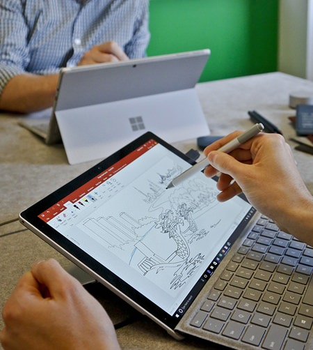 Microsoft's new Surface Pro laptop-tablet hybrid's stylus will now mimic pencil shading when tilted, much like the Apple Pencil for iPad Pro tablets. Along with this, Microsoft plans upgrades to its popular Office software with new pencil-like features. (AP Photo/Bebeto Matthews)