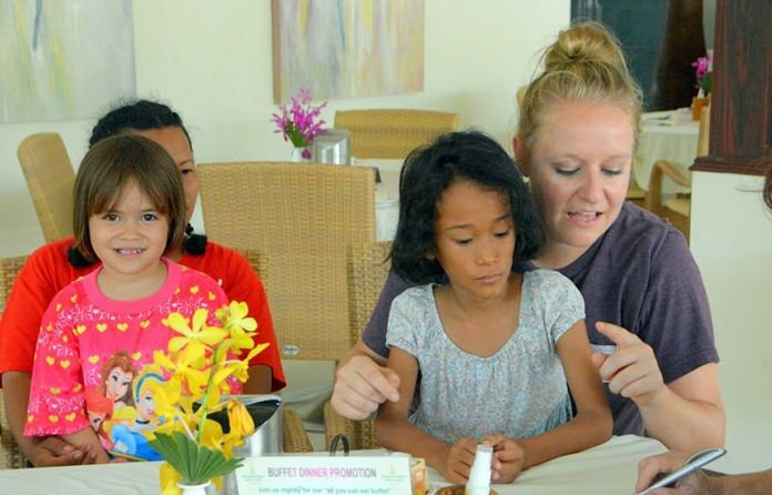 Kathie Mount plays with some children.